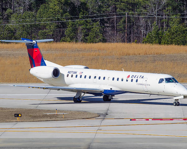 Poster featuring the photograph Delta Airlines ERJ-145LR by Richard Jack-James