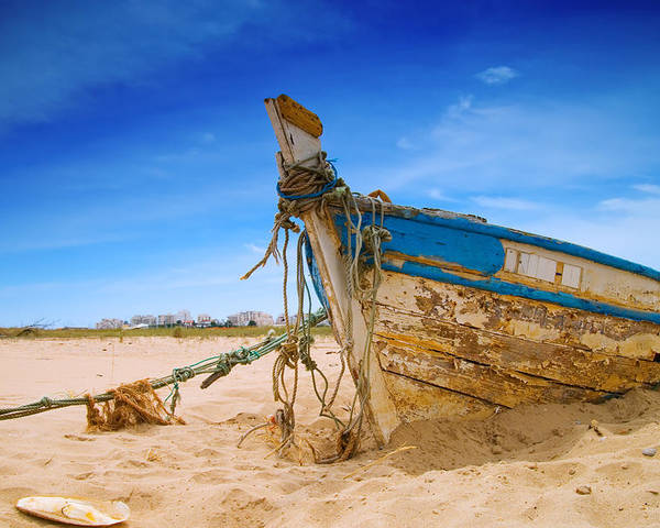 Fishing Boat Poster featuring the photograph Dilapidated Boat At Ferragudo Beach Algarve Portugal by Amanda Elwell