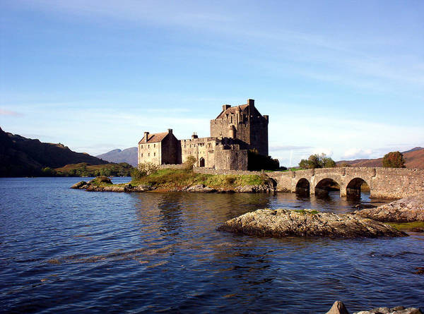 Clan Macrae Poster featuring the photograph Eilean Donan Castle Kintail Scotland by Rodger Insh