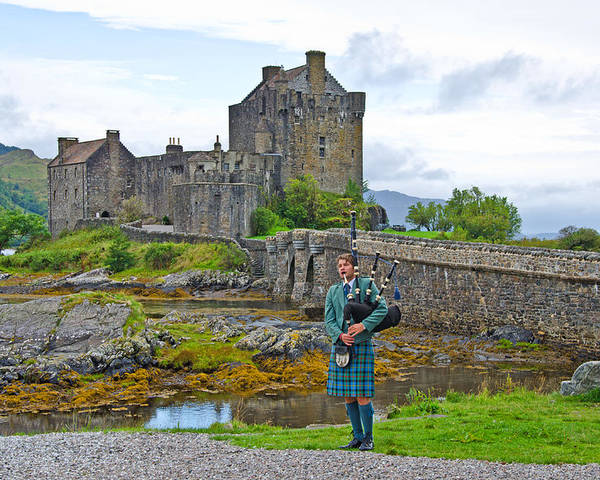 Eilean Donan Castle Poster featuring the photograph Eilean Donan Castle And The Lone Piper by Chris Thaxter