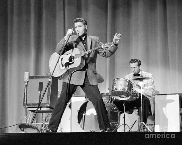 Elvis Presley Poster featuring the photograph Elvis Presley and D.J. Fontana performing in 1956 by The Harrington Collection