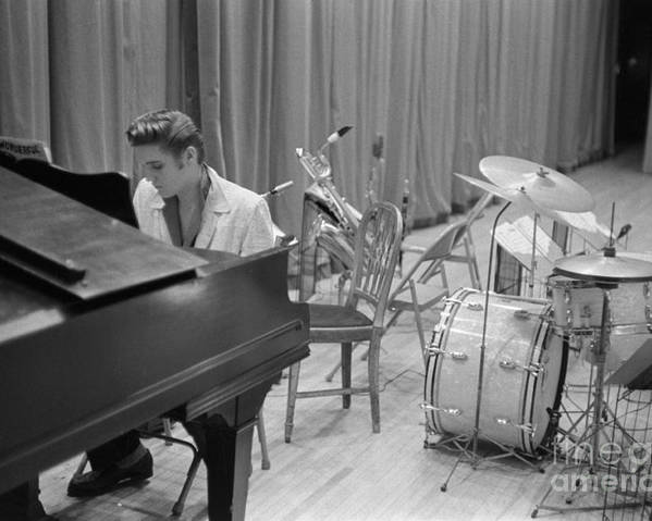Elvis Presley Poster featuring the photograph Elvis Presley on piano waiting for a show to start 1956 by The Harrington Collection