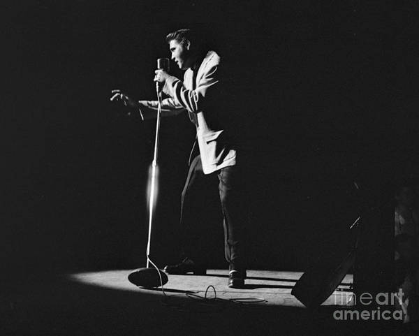 Elvis Presley Poster featuring the photograph Elvis Presley on stage in Detroit 1956 by The Harrington Collection