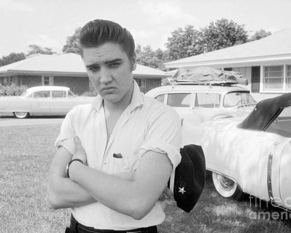 Elvis Presley Poster featuring the photograph Elvis Presley with his Cadillacs 1956 by The Harrington Collection