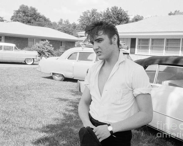 Elvis Presley Poster featuring the photograph Elvis Presley with his Cadillacs by The Harrington Collection