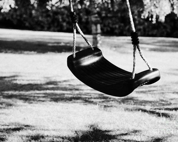 Empty Poster featuring the photograph Empty Plastic Swing Swinging In A Garden In The Evening by Joe Fox