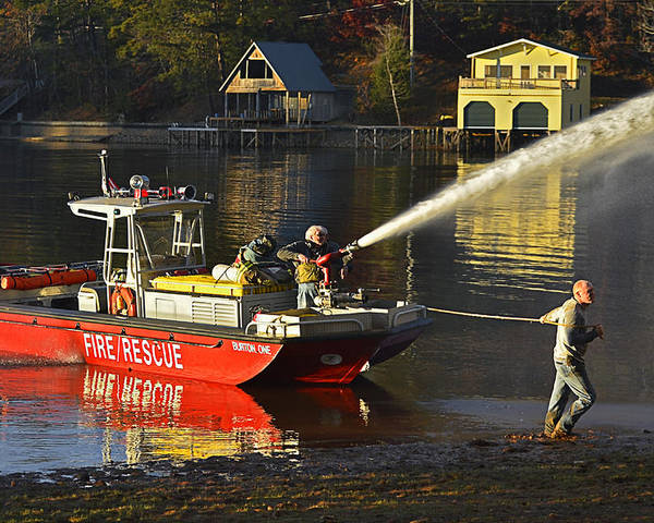 Firemen; Fire; Fireboat; Men; Lake; Water; Shore; Burning; House; Danger; Job; Industry; Profession; Work; Workers; People; Men; Talking; Ready; Equipment; Pumper; Protection; Site; Place; Safe; Save; Fighting; Spraying Poster featuring the photograph Fire Boat by Susan Leggett