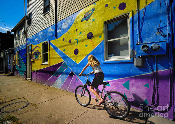 Allegheny County Poster featuring the photograph Girl Rides Bicycle Past Mural On The South Side Of Pittsburgh by Amy Cicconi