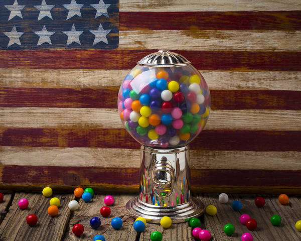 Bubblegum Machine American Poster featuring the photograph Gumball Machine And Old Wooden Flag by Garry Gay