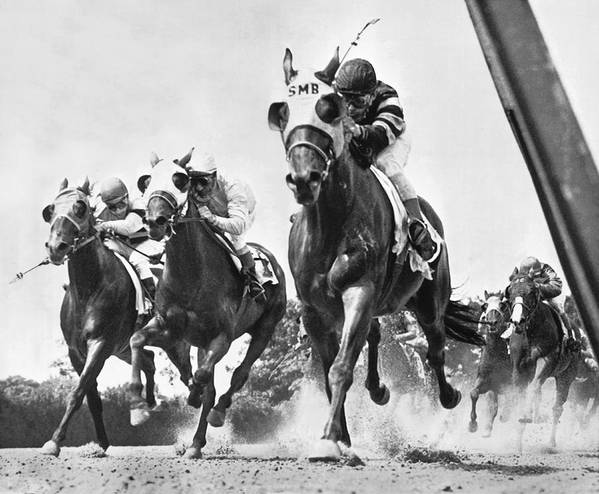 1950s poster featuring the photograph horse racing at belmont park by underwood archives