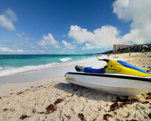 Atlantic Ocean Poster featuring the photograph Jet Ski On The Beach At Atlantis Resort by Amy Cicconi