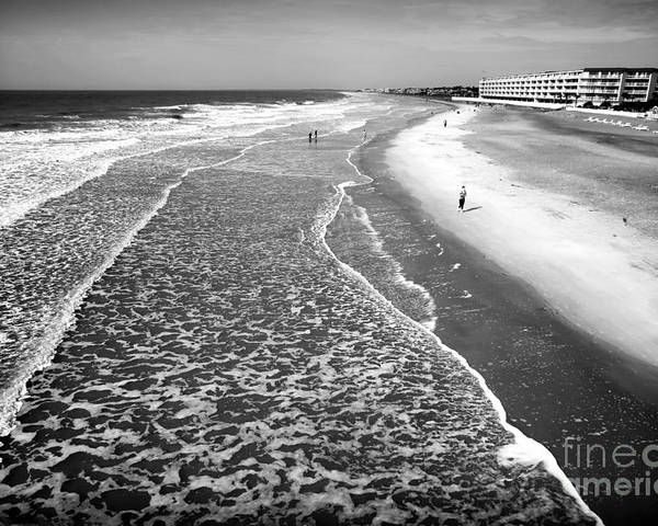 Jogging At Folly Beach Poster featuring the photograph Jogging At Folly Beach by John Rizzuto