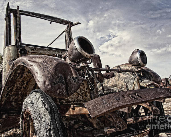 Old Truck Poster featuring the photograph Junk Yard Sentinel Stands by Lee Craig