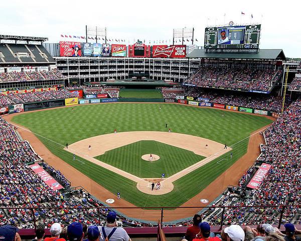 American League Baseball Poster featuring the photograph Kansas City Royals V Texas Rangers by Rick Yeatts