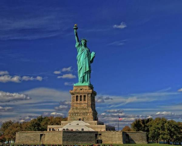 Lady Liberty In New York City Poster featuring the photograph Lady Liberty In New York City by Dan Sproul