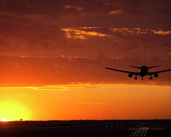 Plane Poster featuring the photograph Landing Into The Sunset by Andrew Soundarajan