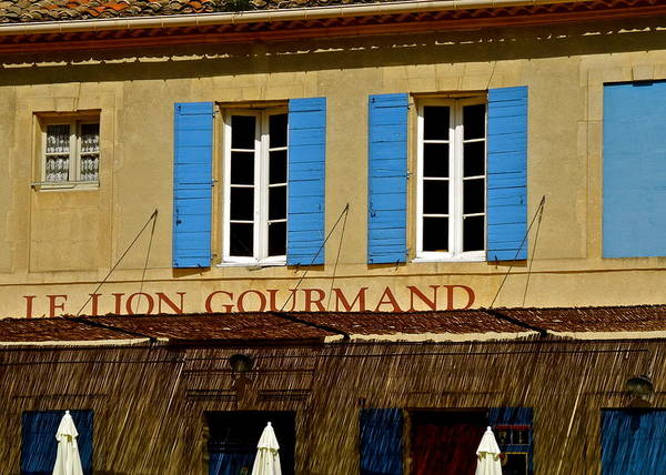 Le Lion Gourmand Poster featuring the photograph Le Lion Gourmand in Arles by Kirsten Giving