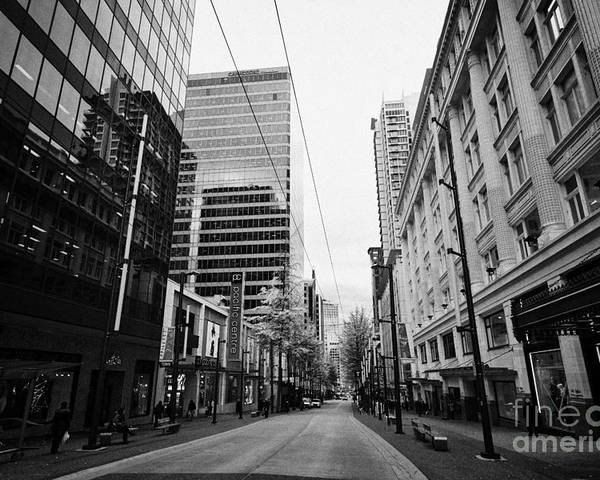 Looking Poster featuring the photograph looking down granville street shopping area between the bay and pacific centre Vancouver BC Canada by Joe Fox