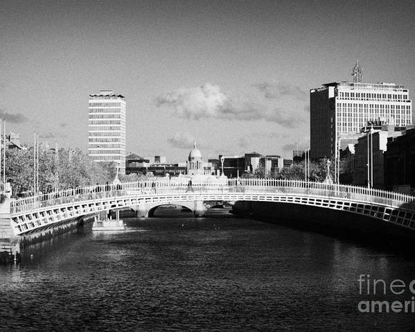 Dublin Poster featuring the photograph Looking Down The Liffey Towards The Hapenny Ha Penny Bridge Over The River Liffey In Dublin by Joe Fox