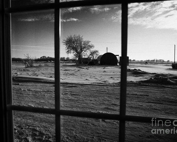 Looking Poster featuring the photograph looking out through door window to snow covered scene in small rural village of Forget Saskatchewan by Joe Fox