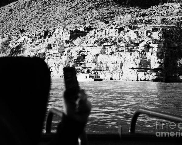 Man Poster featuring the photograph man taking photos with smartphone during boat ride along the colorado river in the grand canyon Ariz by Joe Fox