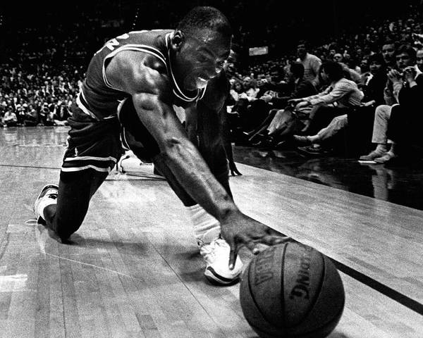 Classic Poster featuring the photograph Michael Jordan Reaches For The Ball by Retro Images Archive
