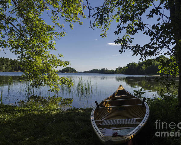 Beauty Poster featuring the photograph Morning Light On A Canoe by Gord Horne