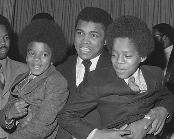 Ali Poster featuring the photograph Muhammad Ali With Young Michael Jackson by Brian Douglas
