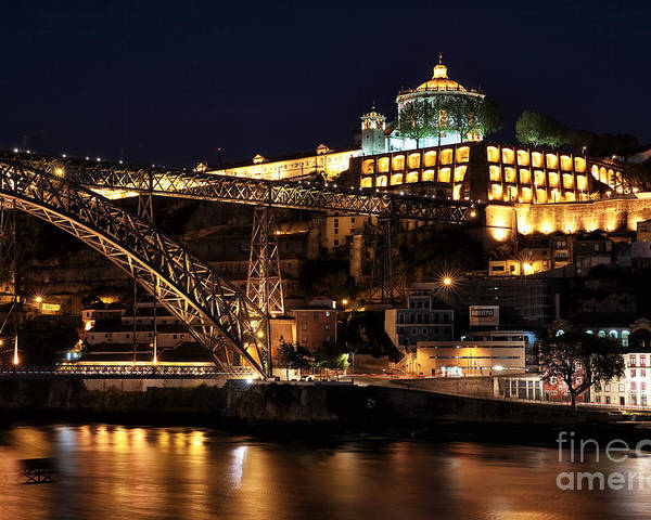 Nighttime In Porto Poster featuring the photograph Nighttime In Porto by John Rizzuto