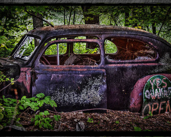 Old Car Poster featuring the photograph Old Abandoned Car In The Woods by Paul Freidlund