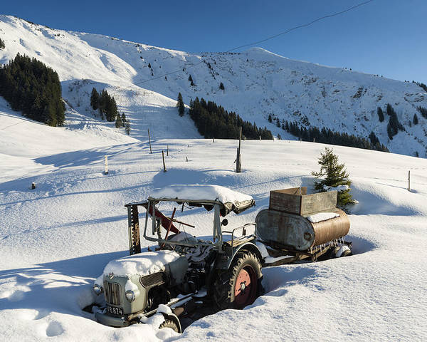 Tractor Poster featuring the photograph Old Tractor In Winter With Lots Of Snow Waiting For Spring by Matthias Hauser