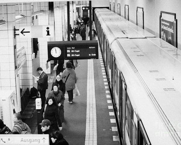 Berlin Poster featuring the photograph passengers along ubahn train platform Friedrichstrasse Friedrichstrasse u-bahn station Berlin by Joe Fox