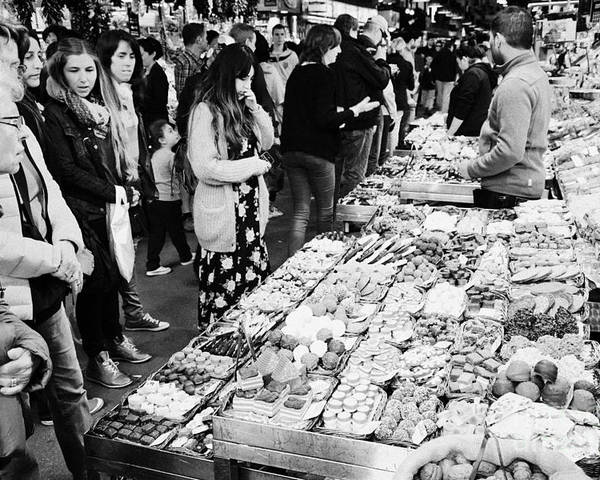 Food Poster featuring the photograph people buying chocolates on display inside the la boqueria market in Barcelona Catalonia Spain by Joe Fox