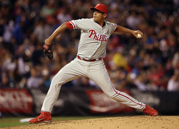 Relief Pitcher Poster featuring the photograph Philadelphia Phillies V Colorado Rockies by Doug Pensinger