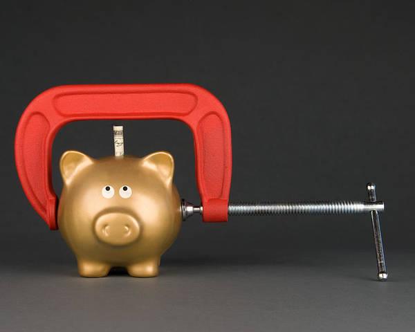Piggybank Poster featuring the photograph Piggy Bank Being Squeezed by Joe Belanger