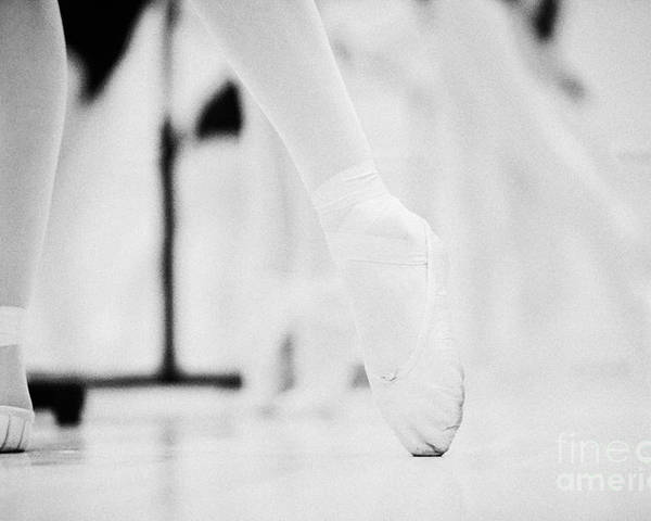 Ballet Poster featuring the photograph Pointed Toe In Ballet Slippers At A Ballet School In The Uk by Joe Fox