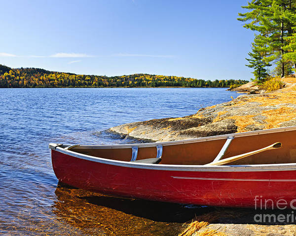 Canoe Poster featuring the photograph Red Canoe On Shore by Elena Elisseeva
