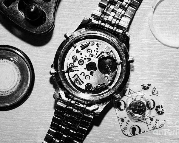 Replace Poster featuring the photograph Replacing The Battery In A Metal Band Wrist Watch by Joe Fox