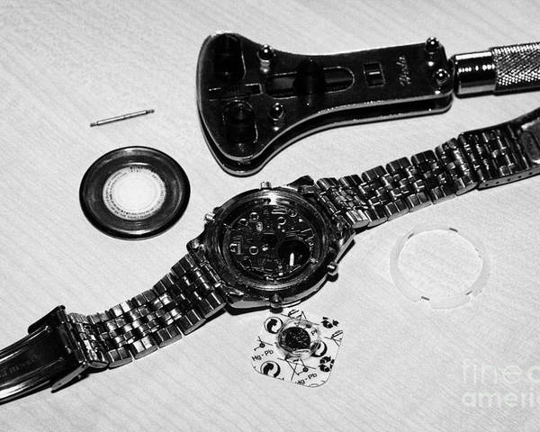 Replace Poster featuring the photograph Replacing The Battery In A Metal Band Wristwatch by Joe Fox