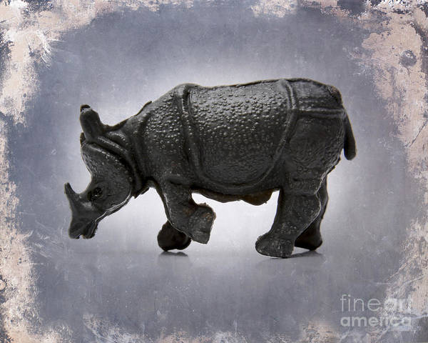 Animal Representation  Auto Post Production Filter  Color Image  Craft  Figurine  France  Gray Background  Horizontal  No People  Photography  Rhinoceros  Single Object  Studio Shot  Textured Effect  Toy Animal  Wildlife Poster featuring the photograph Rhinoceros by Bernard Jaubert