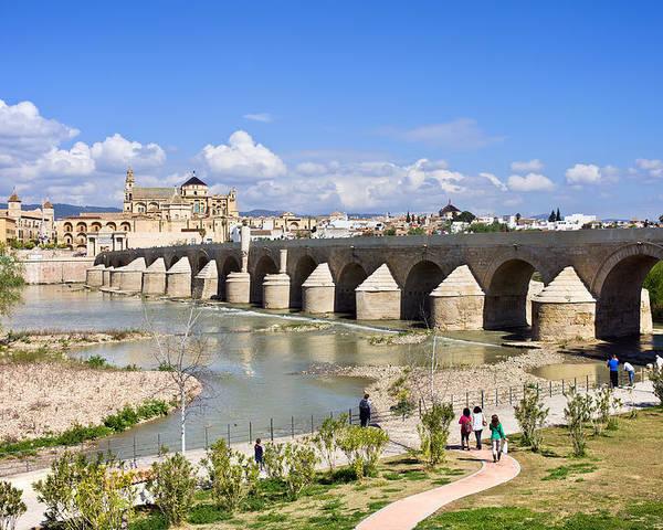 Ancient Poster featuring the photograph Roman Bridge In Cordoba by Artur Bogacki