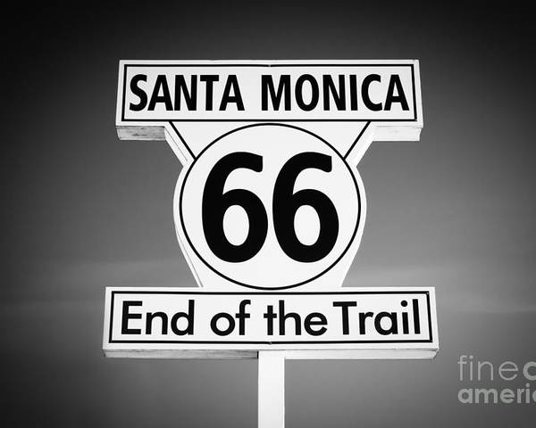 America Poster featuring the photograph Route 66 Sign In Santa Monica In Black And White by Paul Velgos