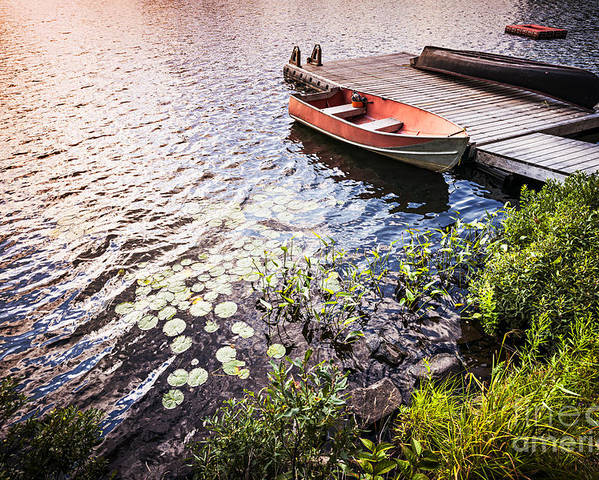 Boat Poster featuring the photograph Rowboat At Lake Shore At Sunrise by Elena Elisseeva