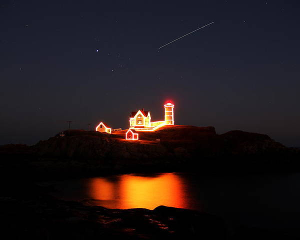 Nubble Lighthouse Poster featuring the photograph Shooter by Andrea Galiffi