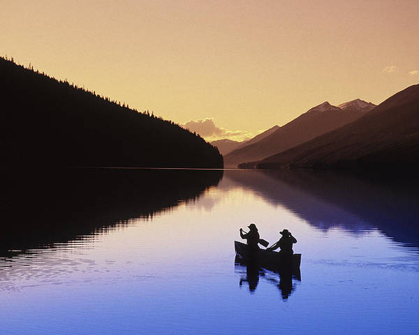B.c. Poster featuring the photograph Silhouette Of Canoeists, Bowron Lake by Chris Harris