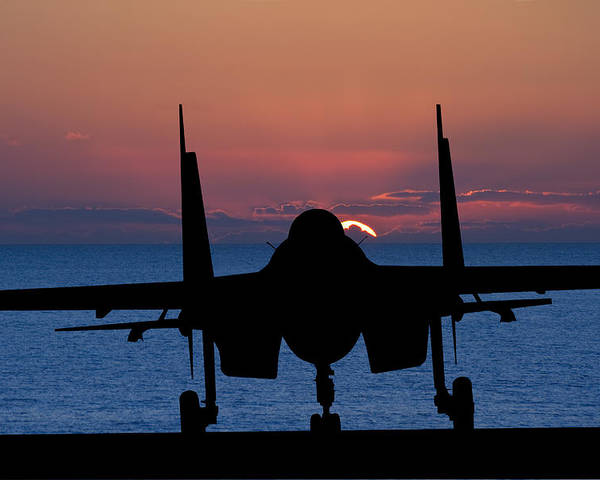 Military Poster featuring the photograph Silhouette Of Military Attack Aircraft Against Vibrant Sunset Sk by Matthew Gibson