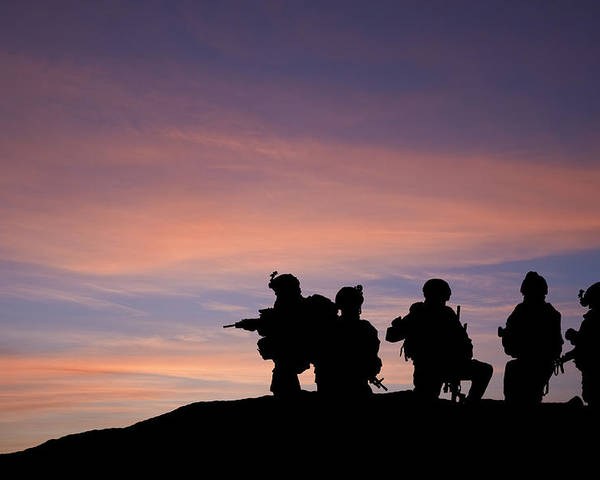 Army Poster featuring the photograph Silhouette Of Modern Troops In Middle East Silhouette Against Be by Matthew Gibson