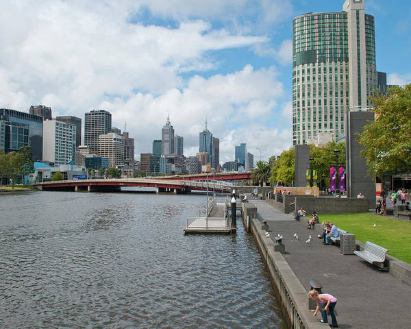 Australia Poster featuring the photograph Skyline Along Yarra River In Melbourne by Bill Bachmann