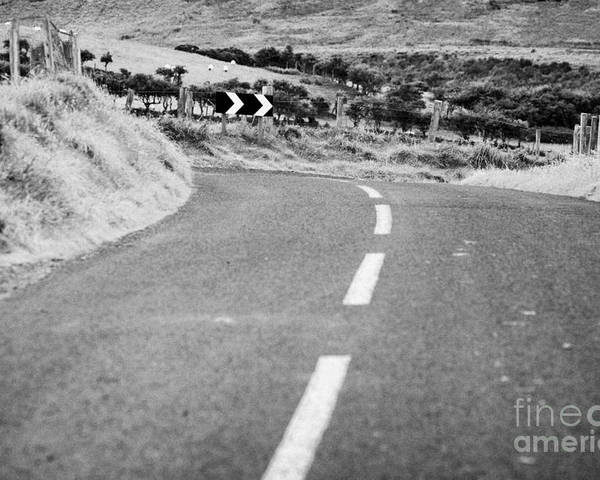 Northern Poster featuring the photograph Small Narrow Country Road Leading To Dangerous Bend In County Antrim Northern Ireland by Joe Fox