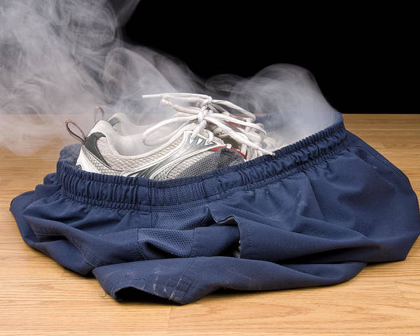 Shoes Poster featuring the photograph Smoking Shorts And Tennis Shoes by Joe Belanger